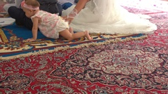 Baby Crawls on Fours on Carpet by Bride Long Wedding Dress Stock Footage
