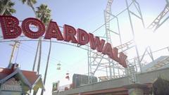 Boardwalk sign tilting down to people in Santa Cruz amusement park in NoCal Stock Footage