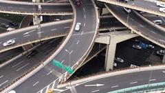 View over busy elevated road junction & skyline, Shanghai, China Stock Footage