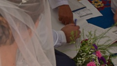 Groom Bride Put Signatures into Register Book on Carpet Stock Footage
