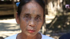 Portrait Chin woman with spider tattoo. Burman tribal people. Myanmar Stock Footage