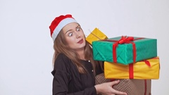Young beautiful fair-haired girl dropping stack of gift boxes over white Stock Footage