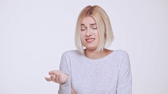 Young beautiful disagreed and critical blonde girl over white background Slow Stock Footage