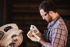 Profession, carpentry, woodwork people concept - carpenter with wood plank and Stock Photos