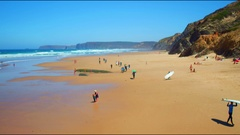 Aerial from surfing lessons at Vale Figueiras in Portugal Stock Footage
