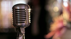 Vintage microphone in a karaoke bar. Bokeh. Slow motion. Stock Footage