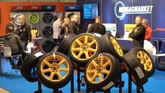 Hall of a large store of spare parts and tires at an auto show. Stock Footage
