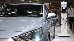 New electric car Hyundai IONIQ Electric is charged from the mains. Stock Footage