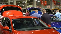 Lot of people and cars of different models at the auto show. Stock Footage
