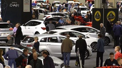 Lot of people and cars of different models.Top view. Stock Footage