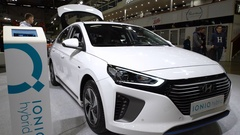 Visitors of auto show examine new electric car Hyundai IONIQ Hybrid. Stock Footage