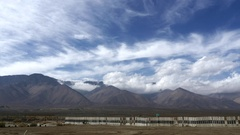 Timelapse of clouds above mountains, on a windy day, in Death valley, Califor Stock Footage