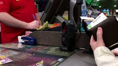 Woman paying credit card for buying lottery ticket Stock Footage