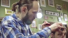 Men's hair cutting scissors in a barber shop. close up view Stock Footage