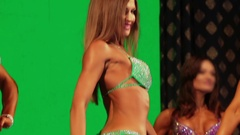 Slim female bodybuilder posing in bikini, fitness competition Stock Footage