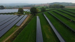 4K Aerial drone footage of installation of solar panels in English countryside Stock Footage