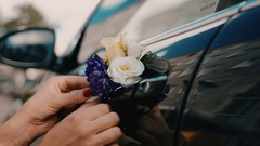 Wedding car decorated with beautiful wedding flowers on the door handles Stock Footage
