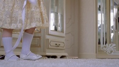 Happy little girl in dress is jumping on the floor with white ribbon. Stock Footage