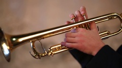 Hands of man pushing button and holding on brazen trumpet close up. Stock Footage