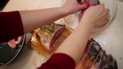 Woman hand rolling fish pieces in meal and putting it on pan Stock Footage