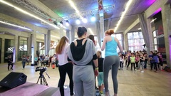 Girls leaving scene and embracing Michael Zhitov on fitness dance Stock Footage
