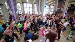Timur Rodriguez and Olga Shelest moving among people on fitness dance Stock Footage