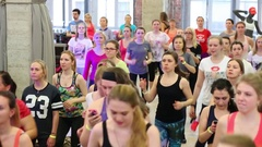 Women jogging in place and rising hands up on fitness dance Stock Footage
