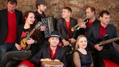 Musical band of eight artist with some instrument playing and singing Stock Footage