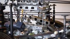 Motor of car Ensemble dividing on parts in Hyundai Motorstudio close up Stock Footage