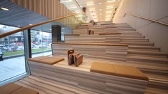 Stairs with sitting place in library in Hyundai Motorstudio Stock Footage
