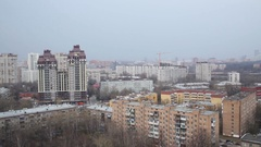 Panorama of city with high apartment houses, trees and sky. Stock Footage