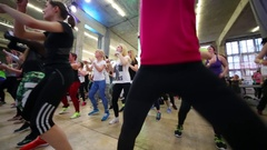 Panorama of women jumping and waving hands on fitness dance Stock Footage