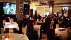 Woman walking through hall of jazz club Kino with table. Stock Footage