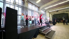 Boys and girls dancing on scene and Michael Zhitov singing on fitness dance Stock Footage