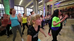 Close up of woman face dancing with another on fitness dance Stock Footage