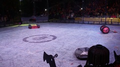 Small robots on wheels turning and riding on arena on Bronebot Stock Footage