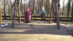 Two children riding on a horse swings Stock Footage