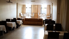 Empty room with table and chairs and photographers on wall Stock Footage
