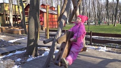 Girl riding on a swing - horses Stock Footage