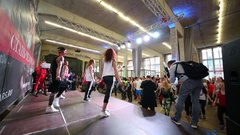 Women and man dancing on scene and many people on fitness dance Stock Footage
