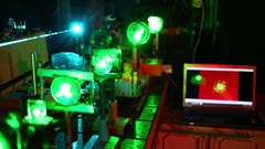 Man putting in blue laser prism disseminating it to many beam in laboratory. Stock Footage
