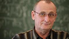 Face of elderly professor in glasses near blackboard close-up. Stock Footage