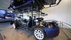 Insides of car - motor, wheels and running truck in Hyundai Motorstudio Stock Footage