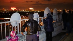 People watching salute from roof at night at Day Defender of Fatherland Stock Footage