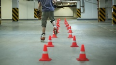 Two man accurately circling two lines of orange cones on roller skates Stock Footage