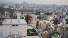 Roof with small green lawn and other cityscape in Seoul at day. Stock Footage