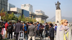 Blonde woman and many reporters near monument to Yi Sun-Sin Stock Footage
