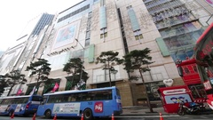 View from car window to decorated building with advertising and buses Stock Footage