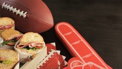Game day football party table with  sub sandwich and snacks. Stock Footage
