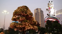Illuminated trees and anthropomorphic raccoon in Lotte World Stock Footage
